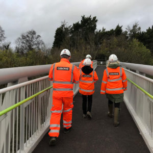 Councillors walking across the East Street footbridge