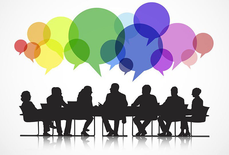 Silhouette of people around a table with speech bubbles above