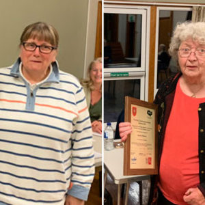 Joan Scott and Audrey Reeves collecting their KALC award 2021